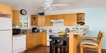 The apartment also has a fully equipped kitchen at Reef Pearl, Grace Bay Beach, Providenciales (Provo), Turks and Caicos Islands.
