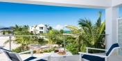 From the upper level balcony you have partial views of the marina and sea at this Turks and Caicos vacation villa rental.