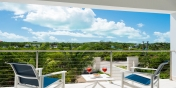 Little Plum Cottage, Grace Bay Beach, Providenciales (Provo), Turks and Caicos Islands, has a top floor master bedroom suite with private patio.