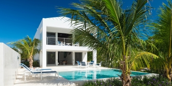 A luxurious, modern, one bedroom beach villa with private swimming pool and fantastic views of the turquoise sea.