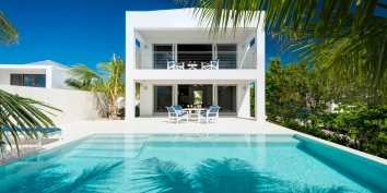 A luxurious, modern, one bedroom villa with private swimming pool and partial views of the marina and sea.