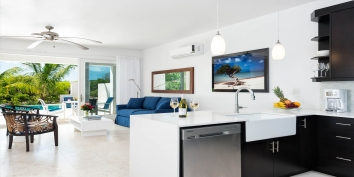 The open concept living room and kitchen at Little Plum Cottage, Grace Bay Beach, Providenciales (Provo), Turks and Caicos Islands.