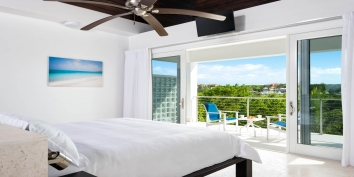 This beautiful and romantic one bedroom villa has a stunning master bedroom suite with partial views.