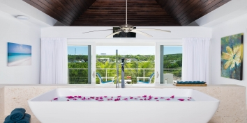 Little Plum Cottage, Grace Bay Beach, Providenciales (Provo), Turks and Caicos Islands has a large bathtub.