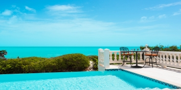 This Turks and Caicos villa rental has an infinity edged swimming pool with stunning views of Long Bay.