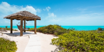 The beachfront tiki-hut at villa Sandy Beaches, Long Bay Beach, Providenciales (Provo), Turks and Caicos Islands.