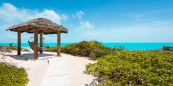 The beachfront tiki-hut at villa Sandy Beaches, Long Bay Beach, Providenciales (Provo), Turks and Caicos Islands.