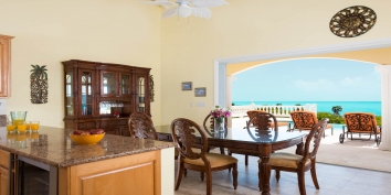 The open plan living, dining and kitchen at villa Sandy Beaches, Long Bay Beach, Providenciales (Provo), Turks and Caicos Islands.