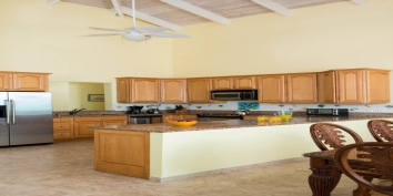 This Turks and Caicos villa rental has a fully equipped kitchen on the upper level and an additional kitchen beach level.