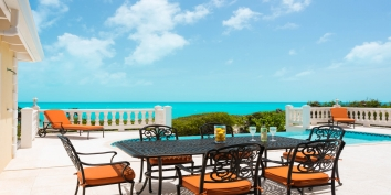 Enjoy alfresco dining at this Turks and Caicos villa rental.
