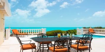 Enjoy alfresco dining at this Turks and Caicos villa rental.