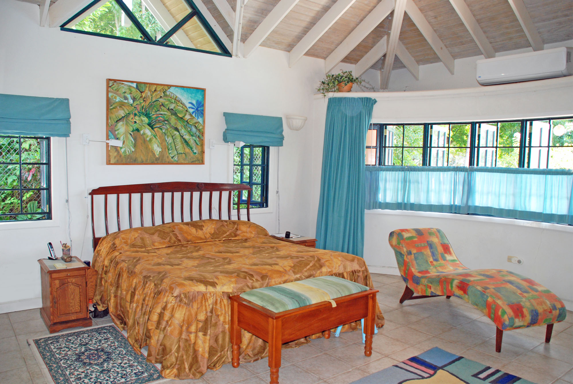 SOL Y MAR VILLA, TOBAGO W.I. Master bedroom shown above. Not seen: Walk-in closet, two-sink two-shower bathroom
