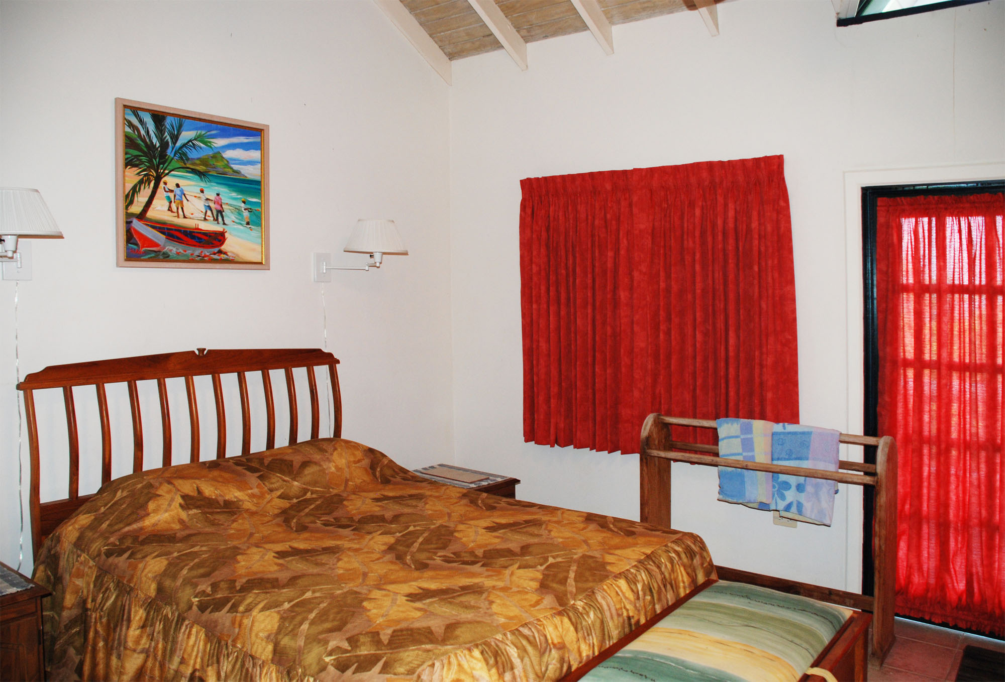 SOL Y MAR VILLA, TOBAGO W.I. Same bedroom, queen bed with two reading lamps above (typical), door to patio