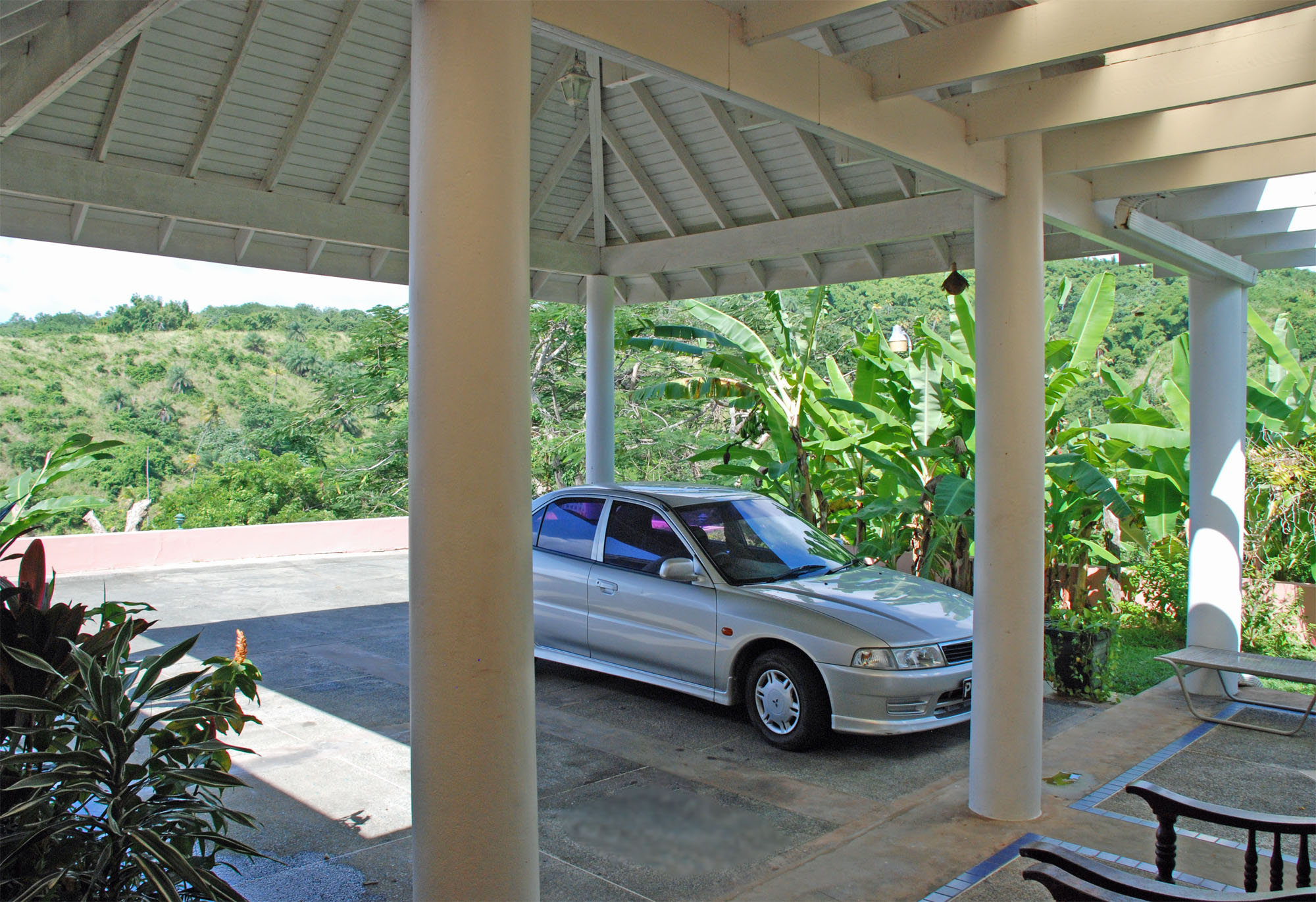 SOL Y MAR VILLA, TOBAGO W.I. Carport on upper level with covered entrance to breakfast area and kitchen
