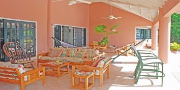 SOL Y MAR VILLA, TOBAGO W.I. Relax in the front patio in conversation areas with sofas, chairs, high chairs, rocker, and  hammock
