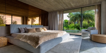 This Turks and Caicos vacation rental features beautiful master bedroom suites.