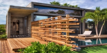 This Caribbean luxury villa rental has wooden slats which provide privacy, shade and natural ventilation allowing the cooling breezes to flow through.