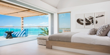 These luxury Caribbean beach villas features multiple areas for relaxing by day or by night.
