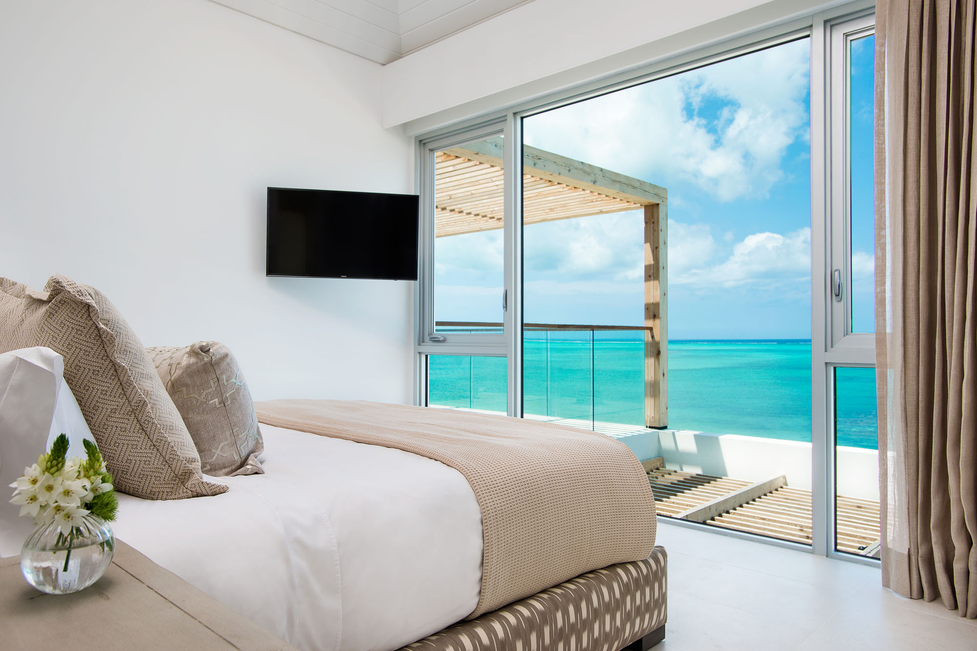 You have the choice between 4 or 5 bedroom beachfront villas at Beach Enclave North Shore, Providenciales (Provo), Turks and Caicos Islands.
