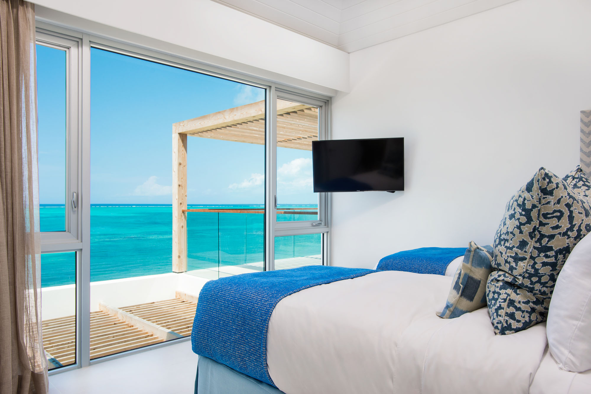 Some of the bedrooms feature two twin beds at these Turks and Caicos luxury beach villa rentals.