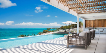 These luxury Caribbean beach villas provide seamless indoor and outdoor living experiences.