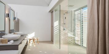 The master bedroom suites have dual vanities at Beach Enclave North Shore Villa 9, Turks and Caicos Islands.