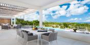Beach Enclave North Shore Villa 9 has both indoor and outdoor dining areas.