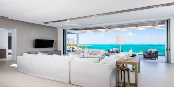 The indoor living room of Beach Enclave North Shore Villa 1, Providenciales, Turks and Caicos Islands.