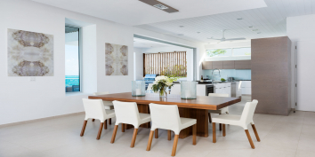 The indoor dining area of this luxury Turks and Caicos villa rental.