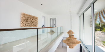 The Great Room of Beach Enclave North Shore Villa 1 features an atrium.