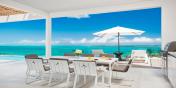 Beach Enclave North Shore Villa 1 has both indoor and outdoor dining areas.