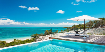 The heated, infinity edge swimming pool at Beach Enclave North Shore Villa 1, Turks and Caicos Islands.