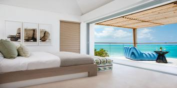 A master bedroom suite at Beach Enclave North Shore Villa 2, Providenciales, Turks and Caicos Islands.