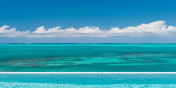 Beach Enclave North Shore Villa 2 has a heated, infinity edge swimming pool with stunning views.