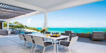 Alfresco dining at Beach Enclave North Shore Villa 2, Providenciales, Turks and Caicos Islands.