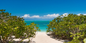 A path leads from Beach Enclave North Shore Villa 8 down to the beautiful beach.