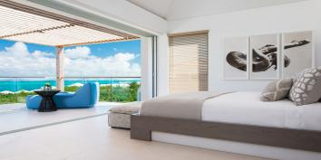 A master bedroom suite at Beach Enclave North Shore Villa 8, Providenciales, Turks and Caicos Islands.