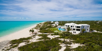 This fully staffed, Caribbean luxury villa rental is located on Long Bay Beach, Providenciales.