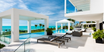This Caribbean luxury villa rental has ample spaces for soaking up the sun or relaxing in the shade.