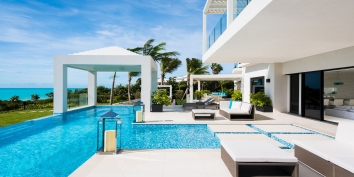 The beachfront, heated, swmming pool of this fully staffed Turks and Caicos luxury villa rental.