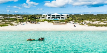 Horseback riding right in front of Triton Luxury Villa, Long Bay Beach, Providenciales (Provo), Turks and Caicos Islands, B.W.I.