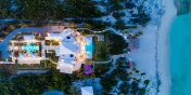 A drone photograph of this fully staffed Caribbean luxury villa rental by night.