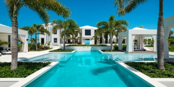 The garden swimming pool is perfect for watching the sunset at Triton Luxury Villa, Long Bay Beach, Providenciales (Provo), Turks and Caicos Islands, B.W.I.