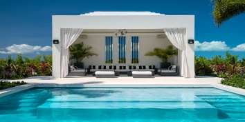 This Caribbean luxury villa rental has multiple cabanas and pavillions for relaxing.