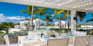 There are dining areas beachside, in the garden and inside at Triton Luxury Villa, Long Bay Beach, Providenciales (Provo), Turks and Caicos Islands, B.W.I.