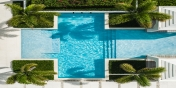 A drone photograph of the heated swimming pool in the garden of Triton Luxury Villa, Long Bay Beach, Providenciales (Provo), Turks and Caicos Islands, B.W.I.
