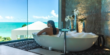 Relax in the soaking bathtub and enjoy the view at Triton Luxury Villa, Long Bay Beach, Providenciales (Provo), Turks and Caicos Islands, B.W.I.
