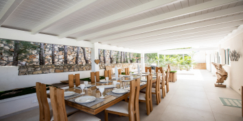 This Caribbean villa rental has a large dining table for all guests.
