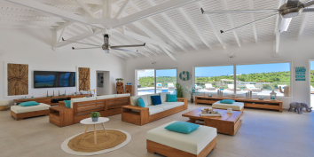 This Caribbean villa rental has a spacious, open plan, living, indoor dining and kitchen area.