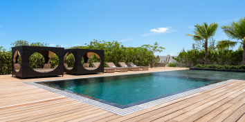 This Turks and Caicos luxury villa rental has a heated, infinity-edge swimming pool.
